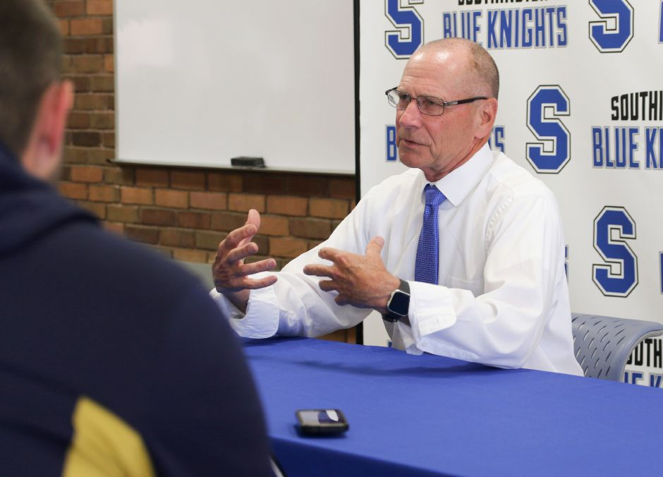 Howie Hewett talks to the media after being formerly introduced Thursday as the new coach of Southington girls basketball. | Spencer Davis, Record Journal