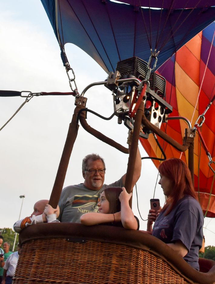 Plainville resident Axel Sundberg, 10, left, rides a hot air balloon with pilot Bruce Buiberg, friend Ellie Keithan, 9, and her mother Rosie Keithan, and his grandmother Melanie Ouellette, during the first night of this year