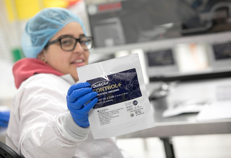 Vanessa Pagan holds up  the new QuikClot Control+,  in production at Z-Medica in Wallingford on Monday. The product is designed for surgical use domestically and abroad as a non-absorbable  dressing for patients with  severe bleeding. Dave Zajac, Record-Journal