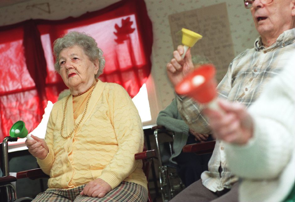 RJ file photo - Helen Koziol, left, participates in the bell choir with other residents of Skyview Nursing and Rehabilitation Center in Wallingford, Dec. 1998.