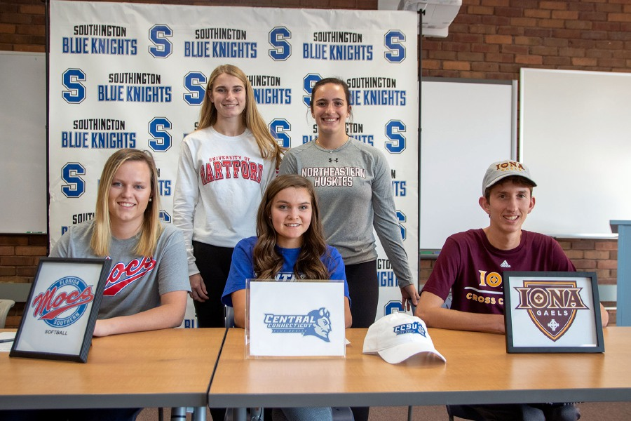 Five seniors from Southington High School signed National Letters of Intent on College Signing Day Wednesday. Southington held its ceremony in the school library. Seated, left to right, are Katie Gundersen (softball, Florida Southern), Katherine Crouse (soccer, Central Connecticut) and Matt Penna (cross country/track, Iona). Standing are track and field teammates Sydney Garrison (Hartford) and Trinity Cardillo (Northeastern).  Aaron Flaum, Record-Journal