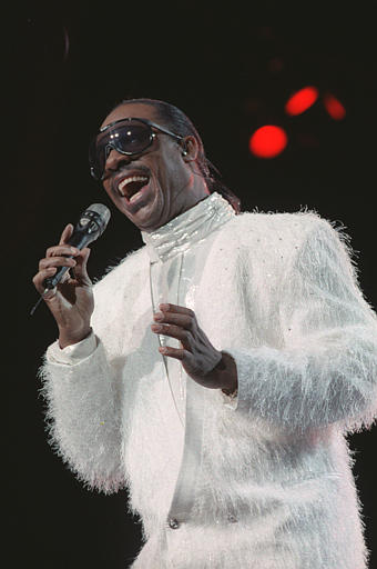 Stevie Wonder belts out a song during the opening performance of an eight-show run at Radio City Music Hall in New York City, Monday night, Aug. 23, 1988. (AP Photo/Ed Bailey)
