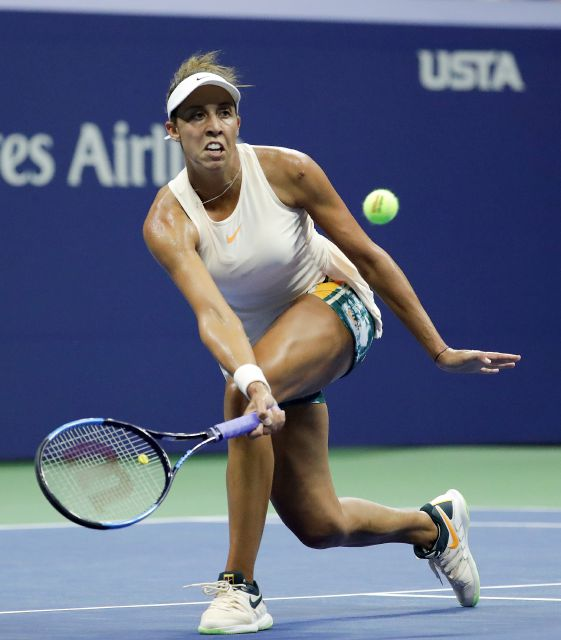 Madison Keys returns a shot to Naomi Osaka, of Japan, during the semifinals of the U.S. Open tennis tournament, Thursday, Sept. 6, 2018, in New York. (AP Photo/Julio Cortez)