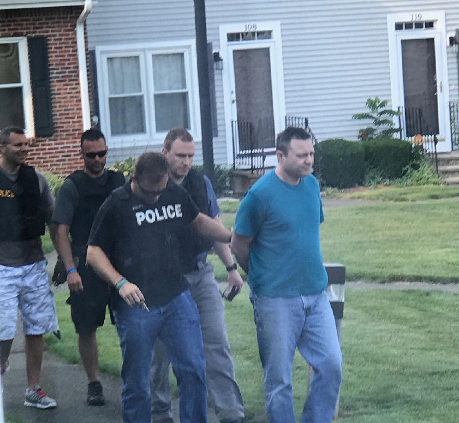 Jeffrey Krahling as he is taken into custody by police at his home