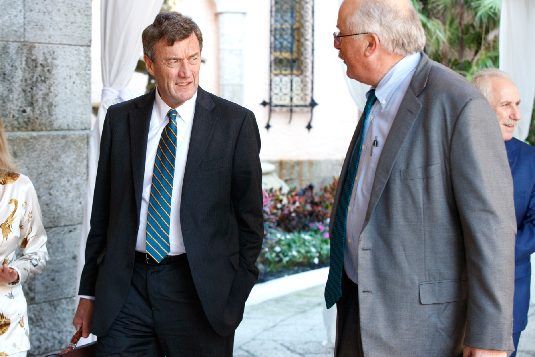 Mayo Clinic CEO John Noseworthy, left, talks with Partners HealthCare CEO and President Dr. David Torchiana, as they arrive at Mar-a-Lago for meetings with President-elect Donald Trump and his transition team, Wednesday, Dec. 28, 2016, in Palm Beach, Fla. (AP Photo/Evan Vucci)