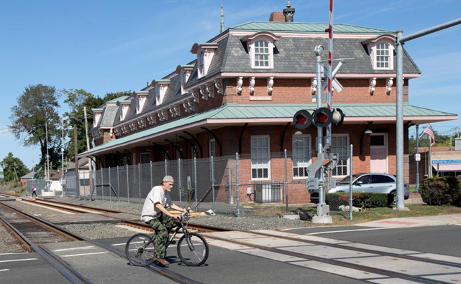 A bicyclist pedals over the tracks at the Quinnipiac Street rail crossing in Wallingford, Fri., Sept. 20, 2019. The police department will participate in a national campaign next week to raise awareness of railroad safety. Dave Zajac, Record-Journal
