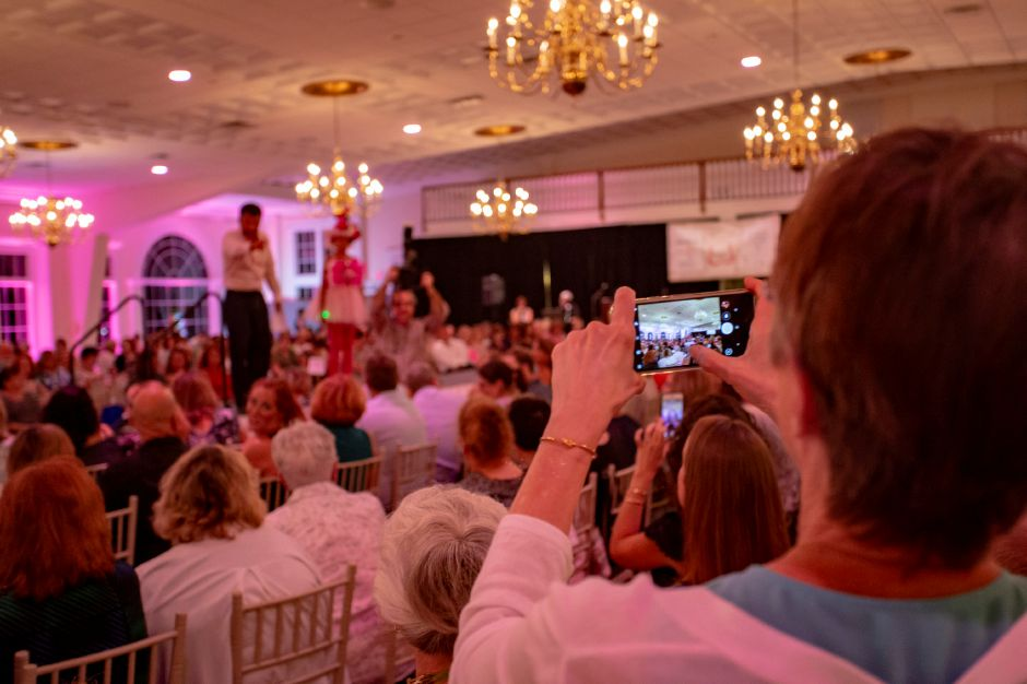 Guests snap pictures of their favorite creations on the runway during the Art Bra 2018 Runway Show and Auction Aug. 9, 2018 at the Aqua Turf in Southington. | Richie Rathsack, Record-Journal