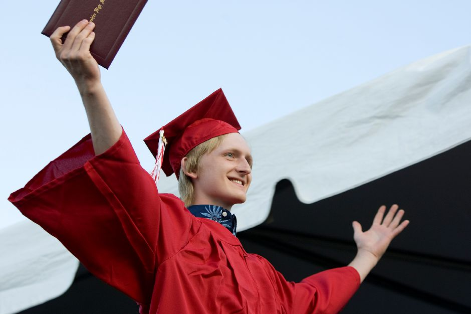 Graduate George Mott celebrates getting his diploma while on stage during graduation ceremonies at Cheshire High School, Friday, June 10, 2016. | Dave Zajac, Record-Journal