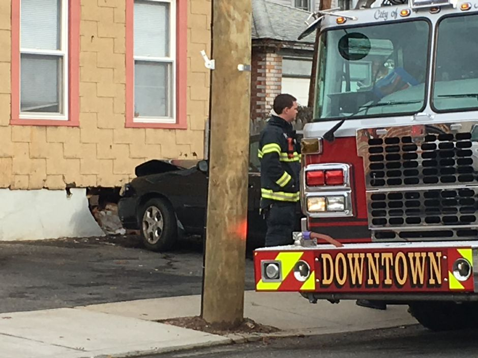 A car crashed into 11 Cooper St., Meriden, Monday afternoon. There were no reported injuries. Dec. 17, 2018.| Ryan Chichester, Record-Journal
