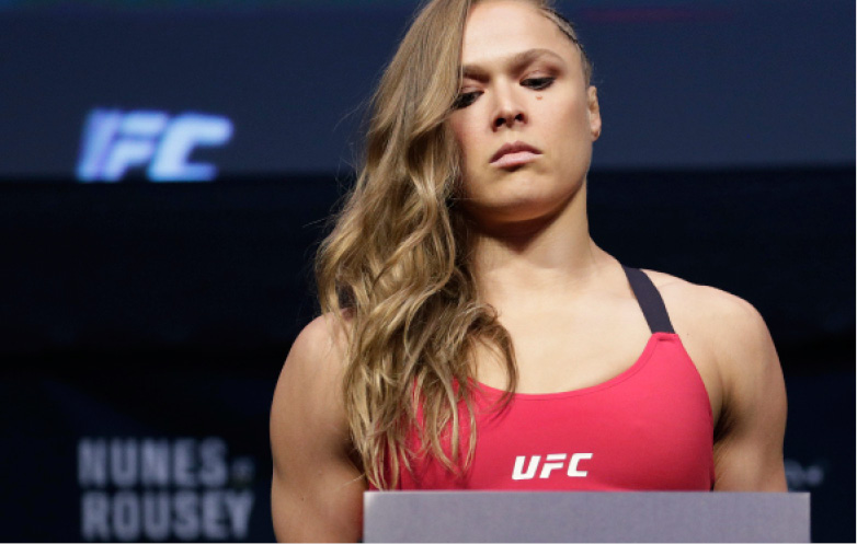 Ronda Rousey poses for photographers during an event for UFC 207, Thursday, Dec. 29, 2016, in Las Vegas. Rousey is scheduled to fight Amanda Nunes in a mixed martial arts women