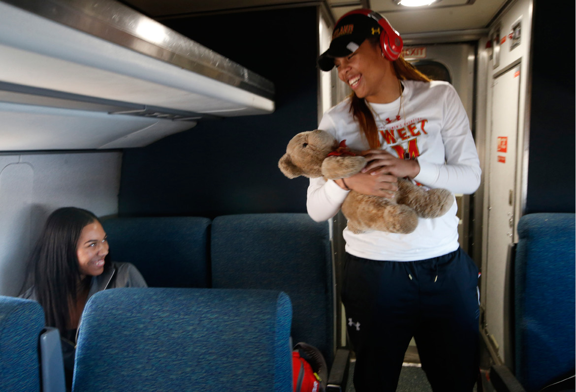 Maryland forwards Aja Ellison, left, and Kiah Gillespie of Meriden joke about whether Gillespie's good luck teddy bear Sirr needs a bath, as the team rode an Amtrak Regional train from Baltimore to Stamford, Conn., Thursday,. Only two of the team's players had ever taken a train, so coach Brenda Frese decided to take the train instead of a bus to the NCAA women's college basketball tournament Bridgeport Regional.| Associated Press