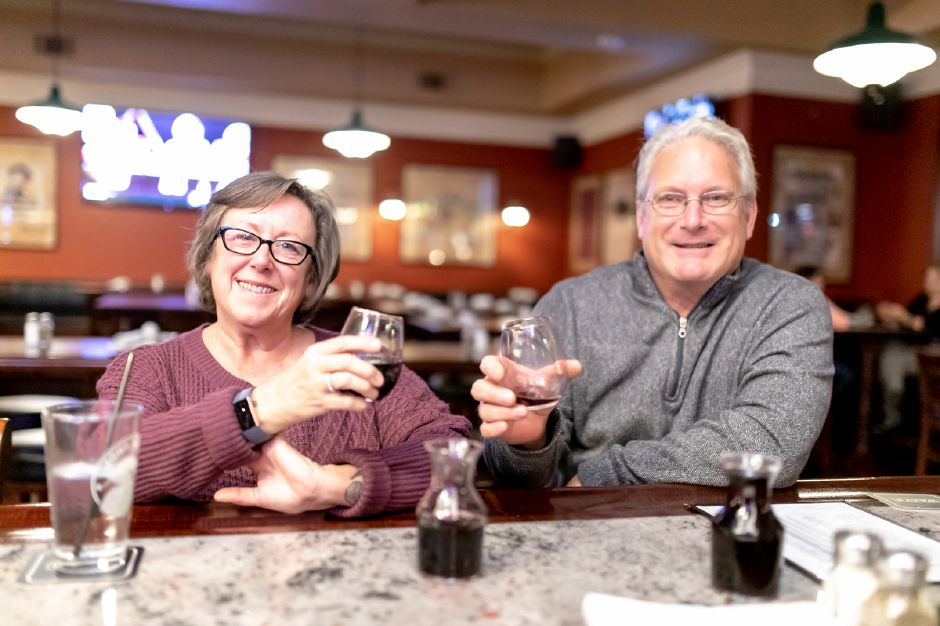 John and Elane Cyr, of Plainville, have a drink at Waxy