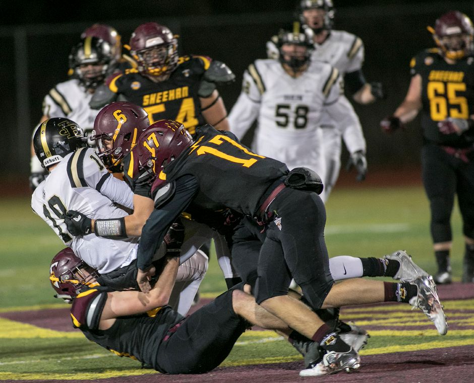 The Sheehan defense takes down Joel Barlow quarterback Trevor Furrer during the first half of the Class M quarterfinals at Sheehan High School, Tuesday, Nov. 28, 2017. | Dave Zajac, Record-Journal