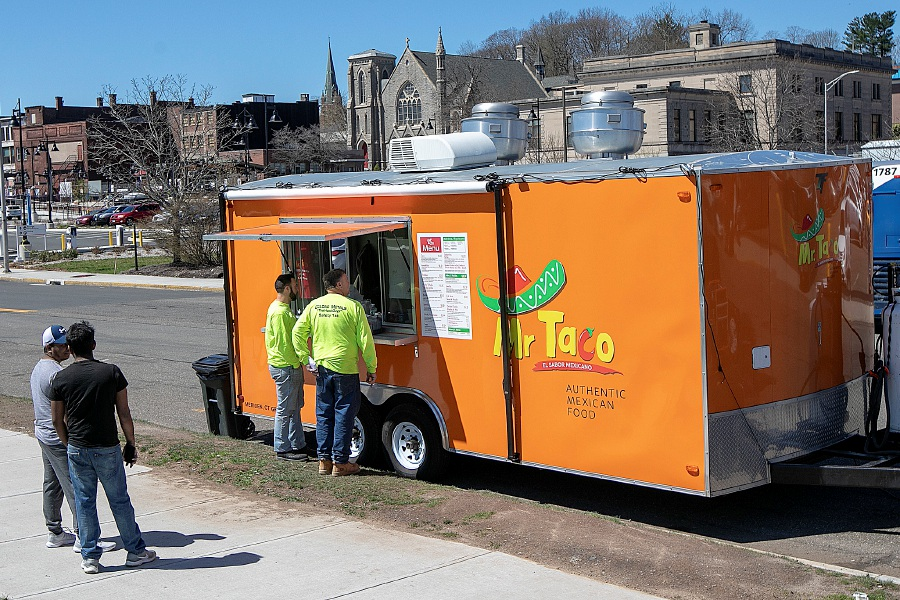 The popular Mr. Taco food truck serves patrons on State Street in Meriden, Tues., Apr. 16, 2019. Dave Zajac, Record-Journal