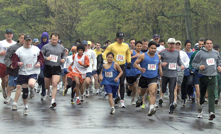 Runners take off at the rainy start of a Meriden Rotary Club 5K at Hubbard Park. File photo, Record-Journal