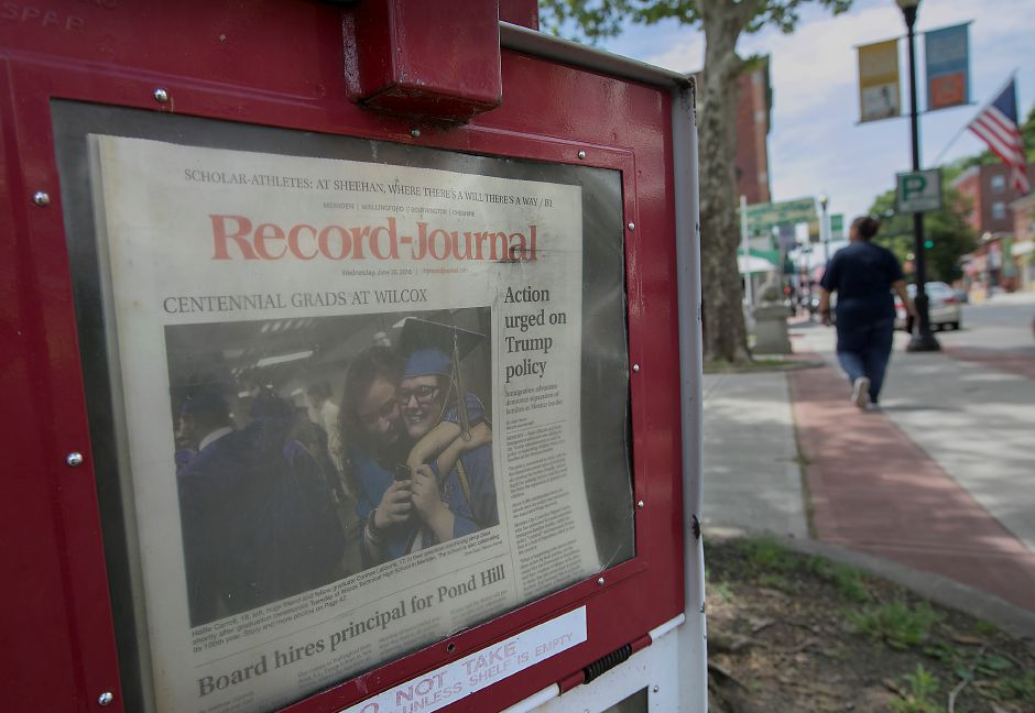 A Record-Journal newspaper box along West Main Street in Meriden, Wednesday, June 20, 2018. A group of statewide newspaper publishers met with lawmakers last week seeking support of a bill that would halt tariffs on printing paper until its impacts are thoroughly reviewed. Dave Zajac, Record-Journal