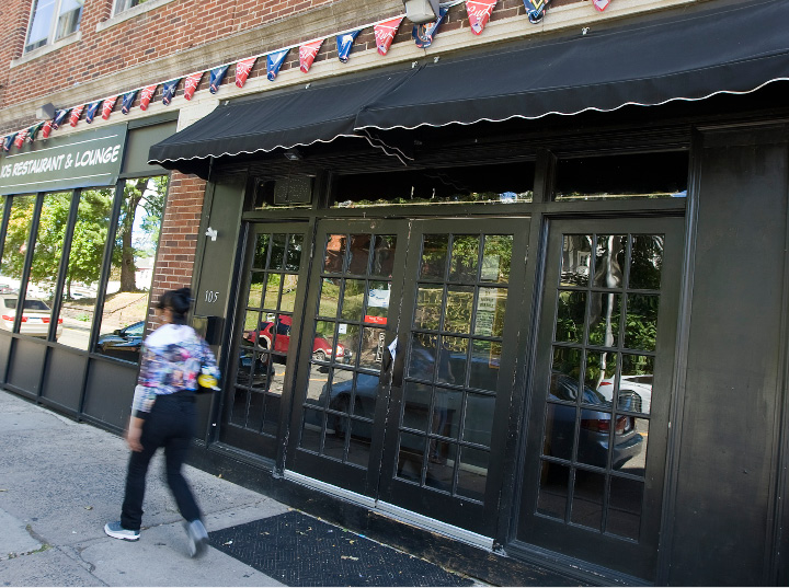 A woman walks past 105 Restaurant & Lounge on Colony Street in Meriden, Thursday, September 15, 2016.  | Dave Zajac, Record-Journal