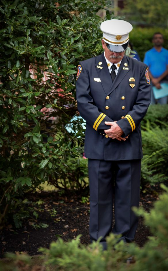 A senior Wallingford fire official bows his head during a prayer at the 9/11 remembrance ceremony at the Wallingford Town Hall on Tuesday, September 11, 2018. | Bailey Wright, Record-Journal