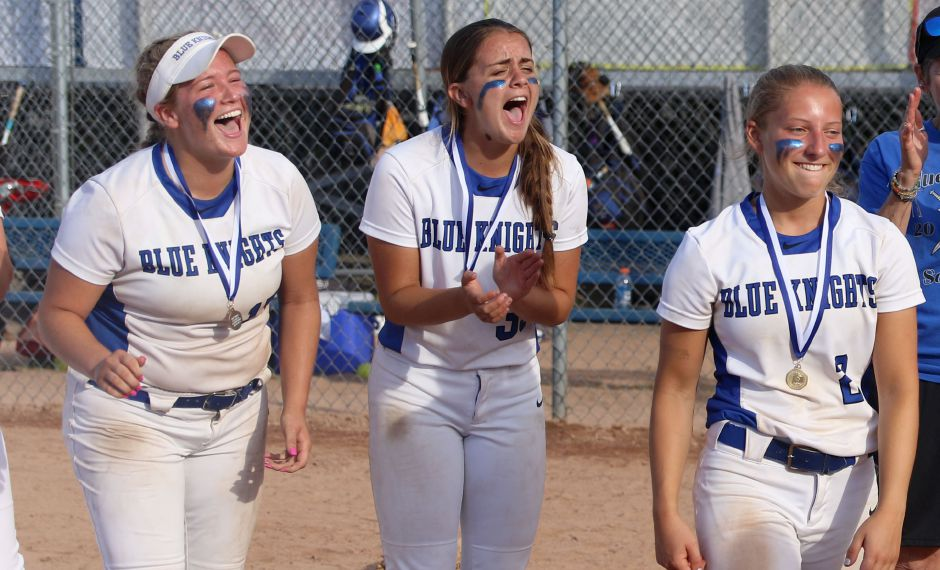 Southington teammates Abby Lamson, left, and Gabby Verderame-Malachowski, center, cheer on Chrissy Marotto, right who was named Class LL Most Valuable Player.Spencer Davis, Record Journal