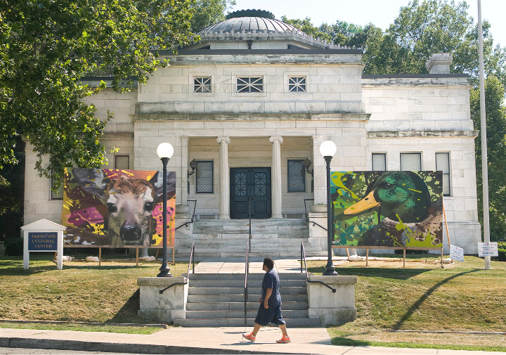"A man walks by the Augusta Curtis Cultural Center on E. Main St. in Meriden where Murals by Ryan ""ARCY"" Christenson of Wallingford are on display, Monday, August 3, 2015.  