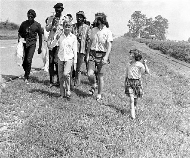 "Lance ""Sweet Willie Wine"" Watson (second from left) and others neared the end of their ""Walk Against Fear"" in north Little Rock, Arkansas, Aug. 23, 1969. The marchers were expected to camp outside the north Little Rock city limits and then march to the State Capitol on Sunday where a rally is scheduled. The 130-mile march began Wednesday morning in West Memphis. The two youngsters, Clare, right and Chris are the children of Tom Flower, right, of San Antonio, Tex. (AP Photo)"
