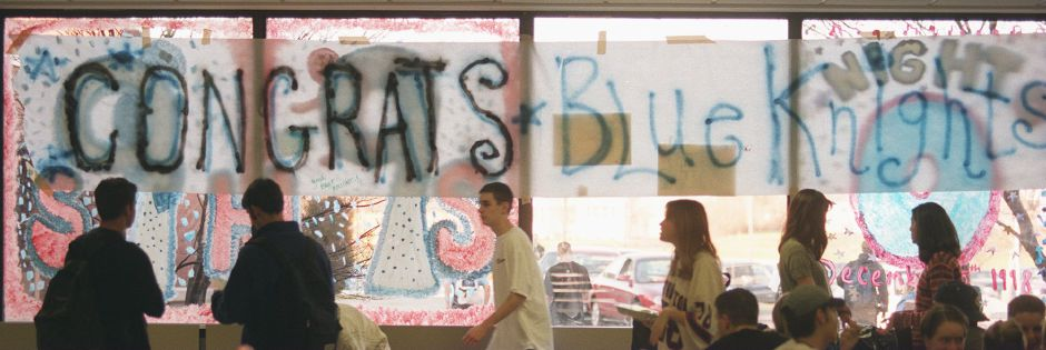 "RJ file photo - Southington High School students walk by a sign reading ""Congrats Blue Knights"" on the windows of the school cafeteria Dec. 4, 1998. The football team meets Norwich Free Academy for the Class LL championships."