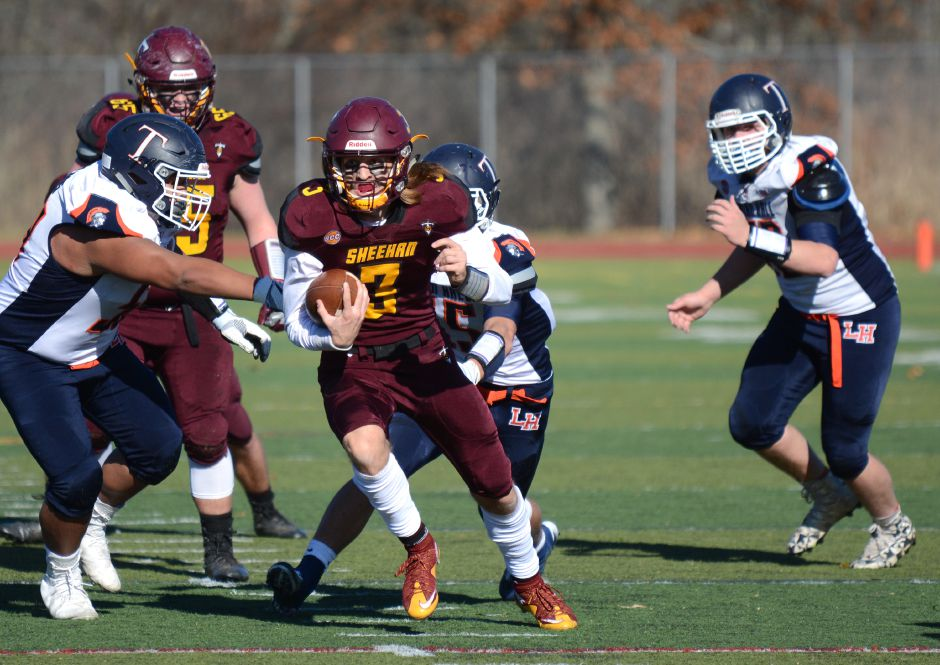 Wes Terzi, of Sheehan, runs in the team's annual Thanksgiving Day football game against Lyman Hall on Thursday, Nov. 23, 2017. The Titans defeated the Trojans, 49-20. | Bryan Lipiner, Record-Journal