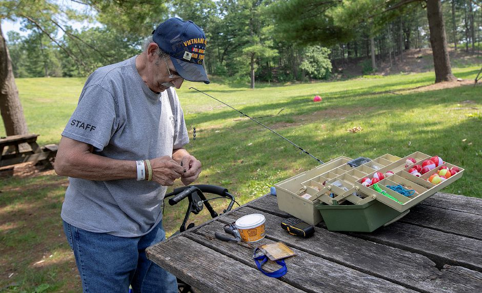 Dan Hadlock, of North Haven, baits a hook while fishing at Wharton Brook State Park in Wallingford on  Wednesday. Hadlock is a U.S. Air Force  veteran who served in the Vietnam War.Photos by Dave Zajac, Record-Journal