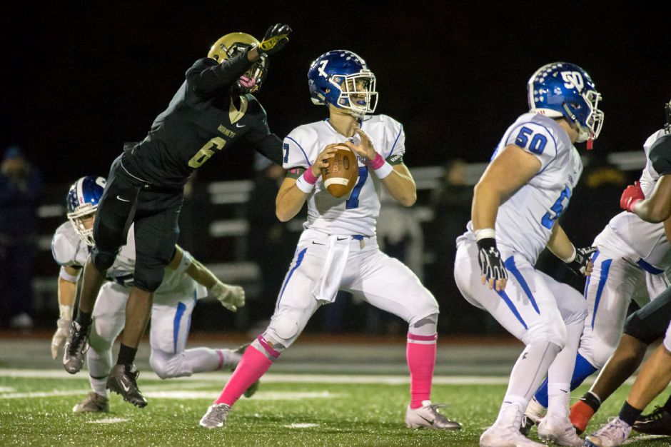 Southington quarterback Jacob Drena completed just six passes Friday night in East Hartford. However, three went for touchdowns in the Blue Knights' 42-27 victory in a top-10 matchup of CCC Division I unbeatens. | Justin Weekes / Special to the Record-Journal