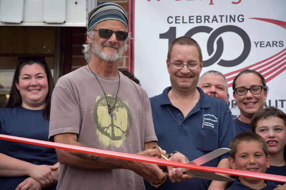 Previous owner Raymond Czapiga and current owner Walter Paluszewski cut a symbolic ribbon Z. Czapiga & Son in Meriden Wednesday evening, June 20, to celebrate the store reaching 100 years in business. | Bailey Wright, Record-Journal