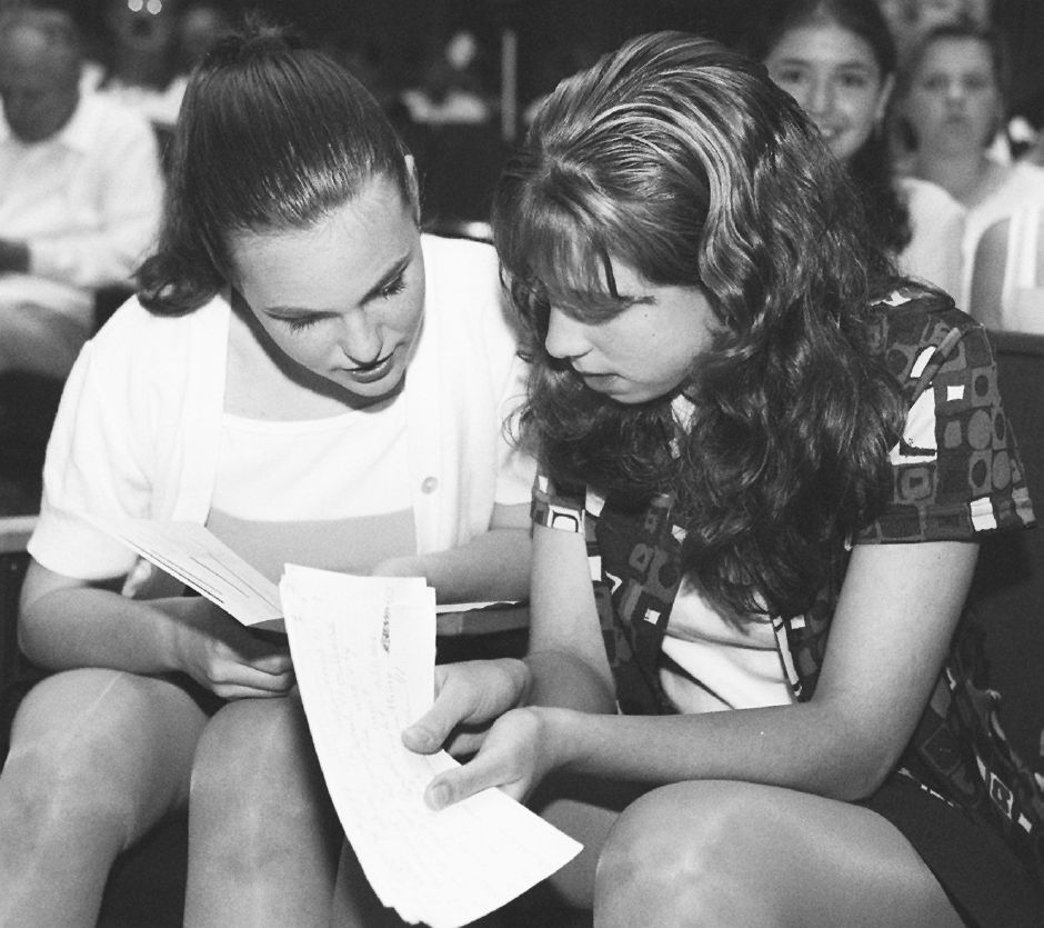 RJ file photo - Eighth-graders Kerry Heeran, left, and Rebecca Wasilewski, from Holy Trinity School, go over the program before the start of the fourth annual Wallingford Rotary Club Essay and Speaking Contest May 26, 1998 at Dag Hammarskjold Middle School. Waskilewski took second place in essay and first in the speaking competition among entries from her school.