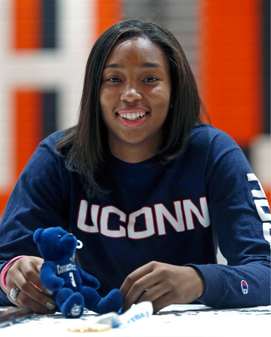 Monacan High School basketball player Megan Walker smiles after signing a letter of intent last November to attend and play for the University of Connecticut. Walker will be watching this year's NCAA Tournament in her UConn sweatshirt, thinking about next March. The consensus high school player of the year leads another steller recruiting class for the Huskies and says they are ready to make their mark on the program. | P. Kevin Morley, Richmond Times-Dispatch via Associated Press