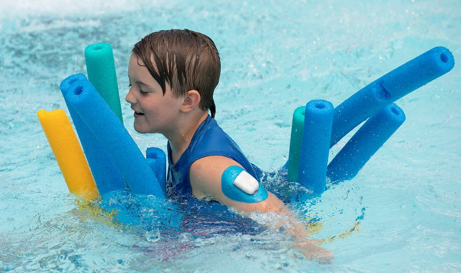 Raymond Ally, 7, of Wallingford, wears an insulin delivery pump on his arm while swimming during a pilot diabetes day camp at the YMCA's Mountain Mist Outdoor Center in Meriden, Thurs., Aug. 8, 2019. The camp is run in conjunction with the Children's Medical Center in Hartford, the Y, and funded through the Lion's Club. Dave Zajac, Record-Journal