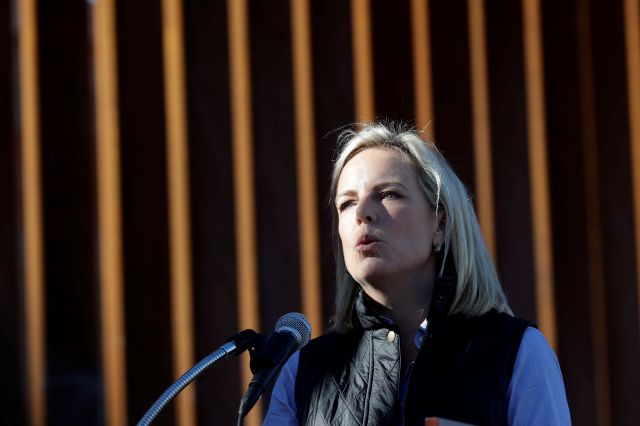 U.S. Department of Homeland Security Secretary Kirstjen Nielsen speaks in front of a newly fortified border wall structure Friday, Oct. 26, 2018, in Calexico, Calif. (AP Photo/Gregory Bull)