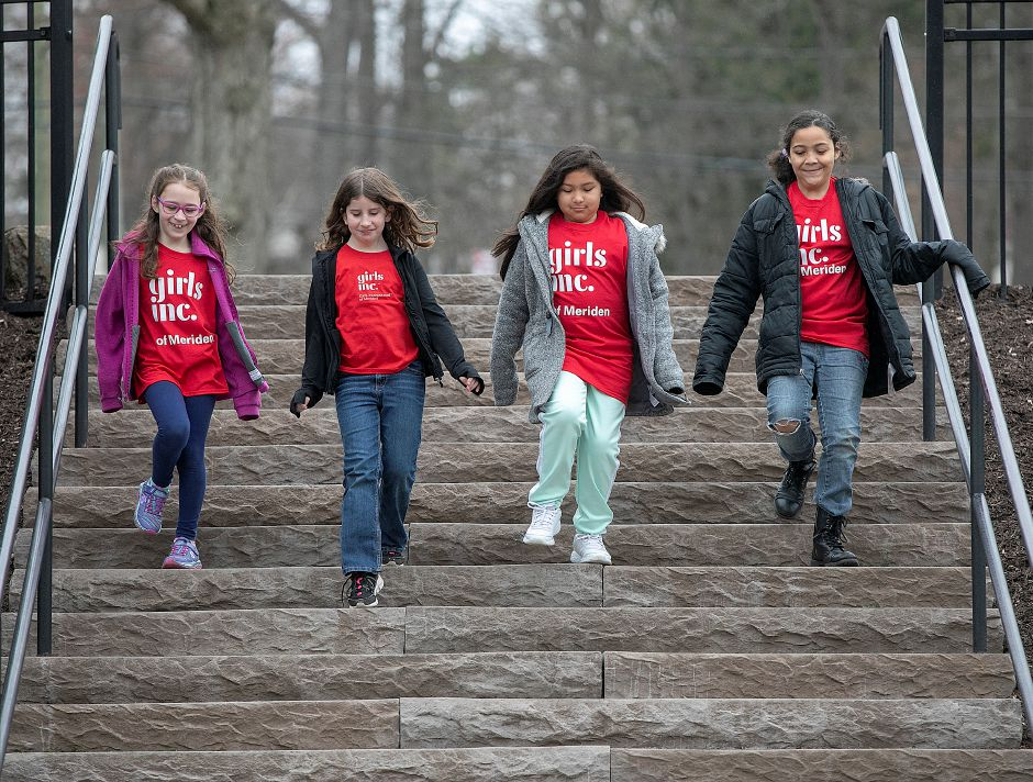 From left, Girls Inc. of Meriden members Emeline Nutter, 8, Samantha Hughes, 8, Izabella Aguirre, 9, and Marielle Henderson, 10, walk down the steps at  Mirror Lake in Meriden