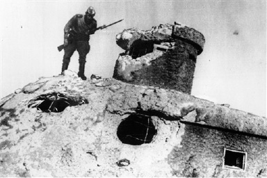 FILE - In this Thursday, Aug. 23, 1945 file picture, a Soviet Red Army soldier peers over the edge of a Japanese fort, at an unknown location in China. On Aug. 8, 1945, the Soviet Union officially declared war on Japan and invaded Japanese-occupied Manchuria in northeastern China. In recent years some historians have argued that a Soviet surprise attack on the Japanese army occupying eastern Asia served as effectively as _ or possibly more than _ the atomic bombs in ending the war. (AP Photo/File)