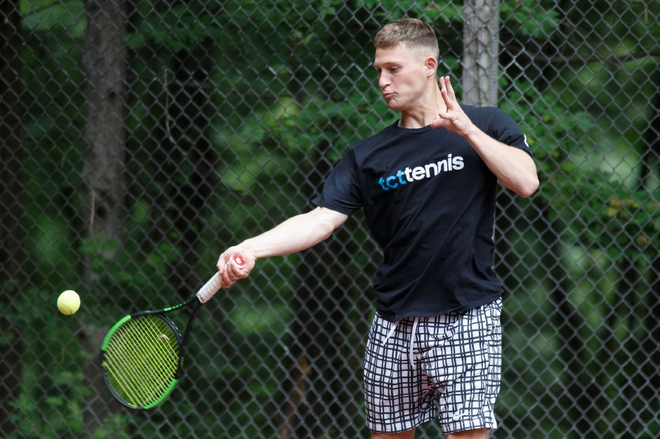 Alex Ruenhorst return a volley in the Men's A Doubles championship match Sunday at the Wint Filipek Sr. Memorial Tennis Tournament at Copper Valley Swim and Tennis Club in Cheshire. | Justin Weekes / Special to the Record-Journal