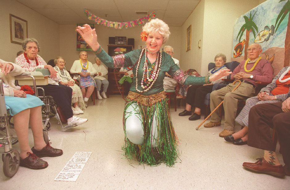 RJ file photo - Lauretta Caron, of New Haven, hulas up a storm in the recreation room of the Skyview Nursing and Rehabilitation Center in Wallingford, May 12, 1998.