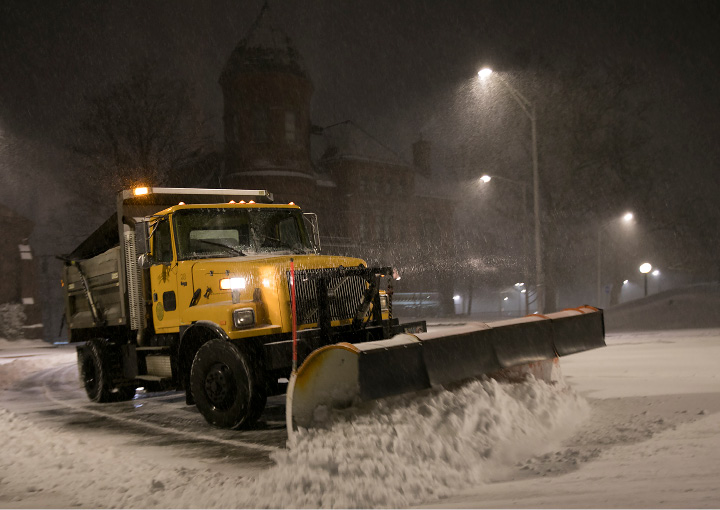 A city plow clears the area around the Meriden Board of Education and City Hall during the nor'easter, Tuesday morning, March 14, 2017. | Dave Zajac, Record-Journal