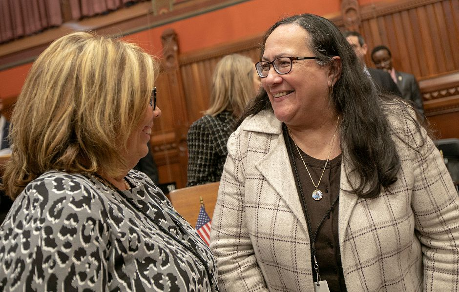 Senator Mary Daugherty Abrams, left, talks with Rep. Hilda Santiago during opening day of the legislative session in Hartford, Jan. 9, 2019. | Dave Zajac, Record-Journal