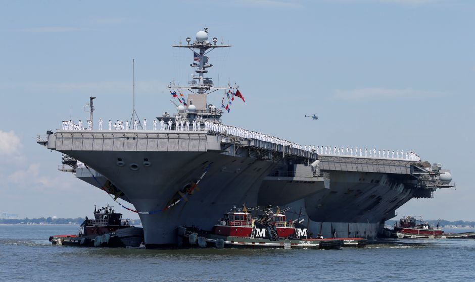 Sailors man the rails as the nuclear powered aircraft carrier Harry S. Truman arrives at Naval Station Norfolk in Norfolk, Va., Wednesday, July 13, 2016. The Truman returns after supporting missions over Iraq and Syria. (AP Photo/Steve Helber)