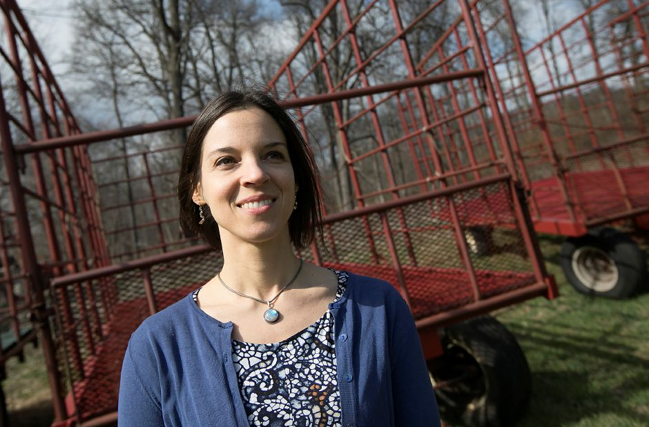 Chauncey Peak advocate Harmony Scaglione, of Meriden, poses at Bilger Farm in Meriden, Wednesday. Scaglione will be the next Meriden Land Trust president, replacing former city manager Roger Kemp. Photos by Dave Zajac, Record-Journal