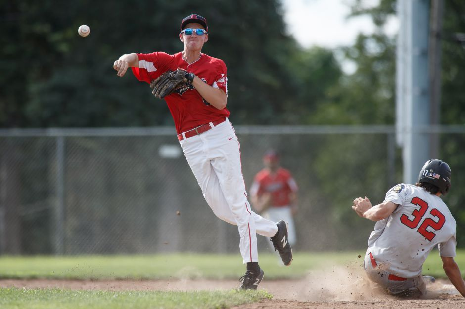 Southington shortstop Jake Romano tries for the double play during Sunday's American Legion South Division super regional game at Ceppa Field in Meriden. | Justin Weekes / Special to the Record-Journal