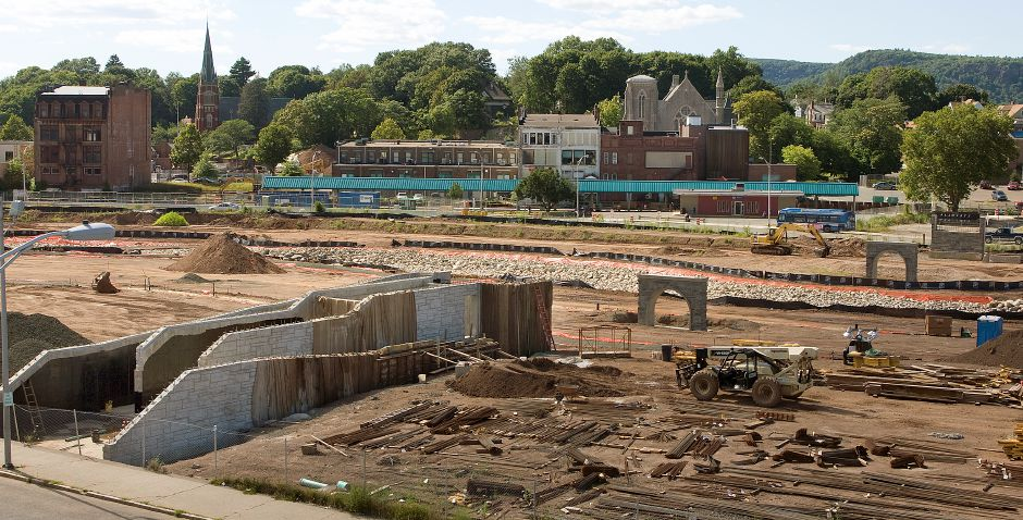 View of the Hub site from the roof of Engine Company 2 on Pratt St. in Meriden, Friday, July 31, 2015. Construction continues on a pedestrian bridge spanning the park from Pratt Street to State Street. Concrete and steel supports built into the park will help carry the open-air bridge. | Dave Zajac / Record-Journal