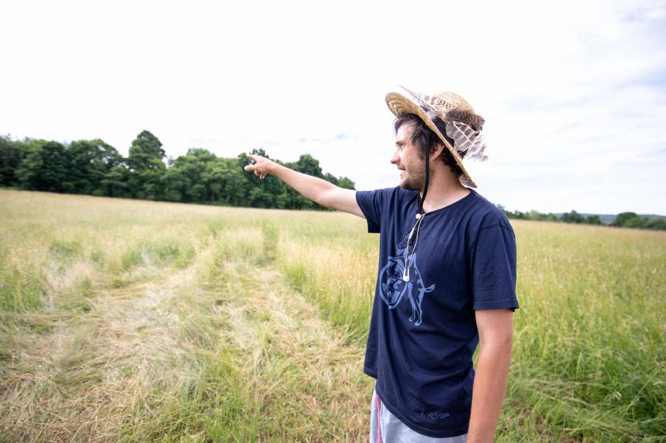 Brent Biederman, owner of Rooster Rise Farm in Berlin, points out the land