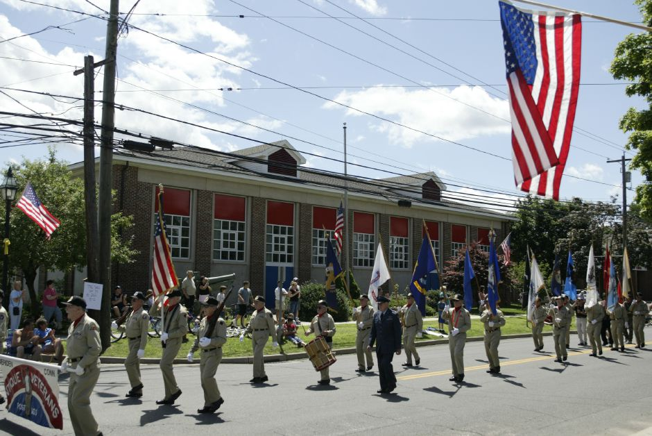 The Antique Veterans march past Hanover School in South Meriden on July 9, 2005. The parade is a belated Memorial Day parade held in between the surrender of Germany in May and Japan in August. (Photo by Christopher Zajac)