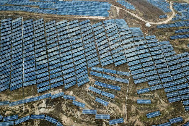In this Nov. 27, 2019, photo, a solar panel installation is seen in Ruicheng County in central China