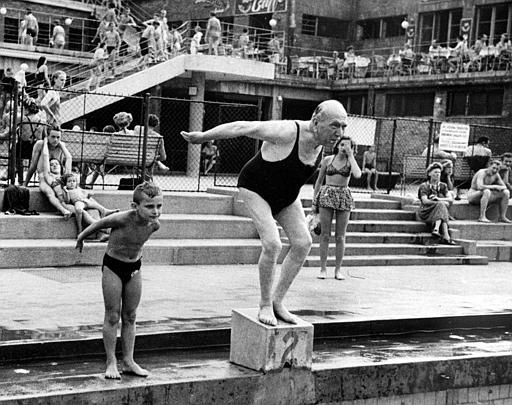 Hungarian architect Alfred Hajos, 72, dives into the Margaret Island Pool, Budapest, Sept. 10, 1949, the pool which he designed and won a golden diploma from the city