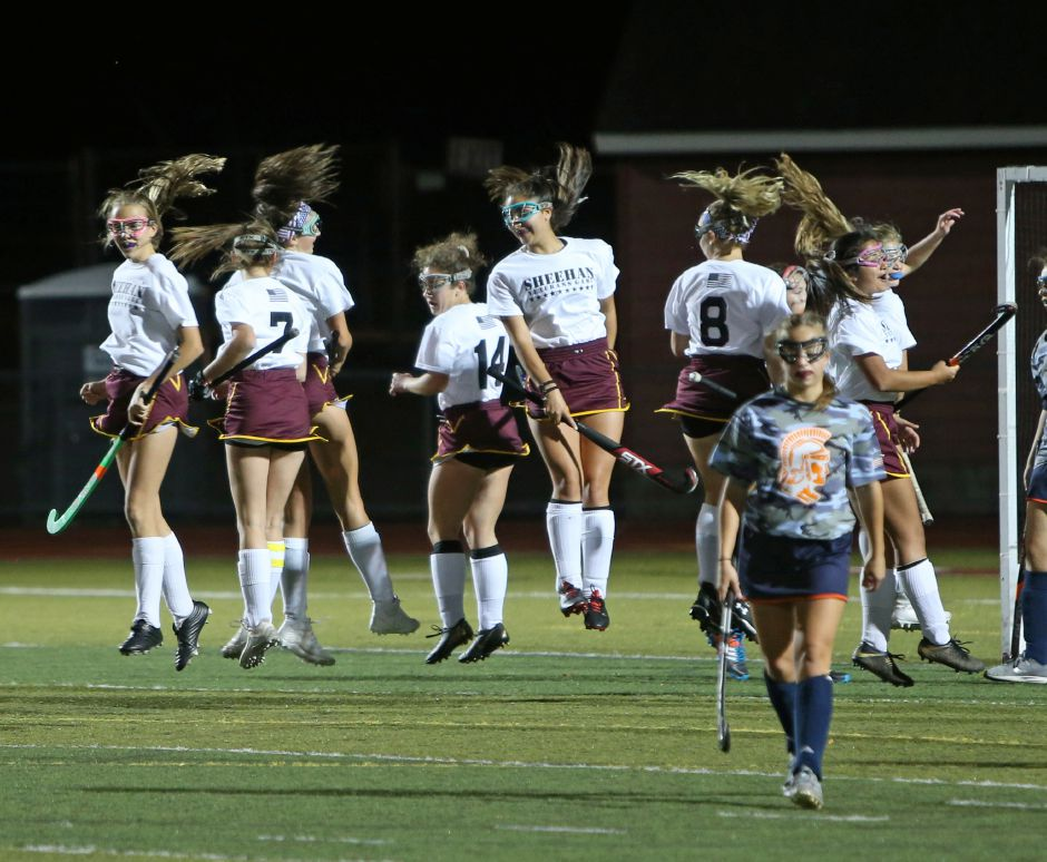 Members of the Sheehan field hockey team celebrate after Sydney Rossacci's goal in the second half broke a 0-0 tie in Thursday's rivalry game with Lyman Hall at Riccitelli Field. Rossacci's goal stood as the game-winner as Sheehan earned its second 1-0 win over LH this season. | Emily J. Tilley, Special to the Record-Journal.