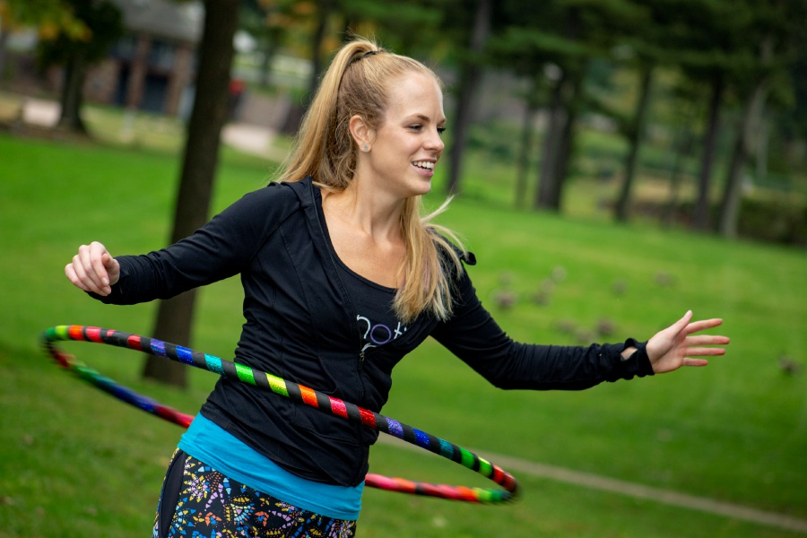 Hoop instructor Kailey Mitchell, of Hipnotic Hoopla, shows off her hoop skills at Hubbard Park on Monday.
